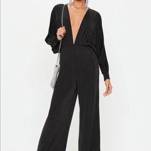 Missguided Slinky black plunge jumpsuit NWT